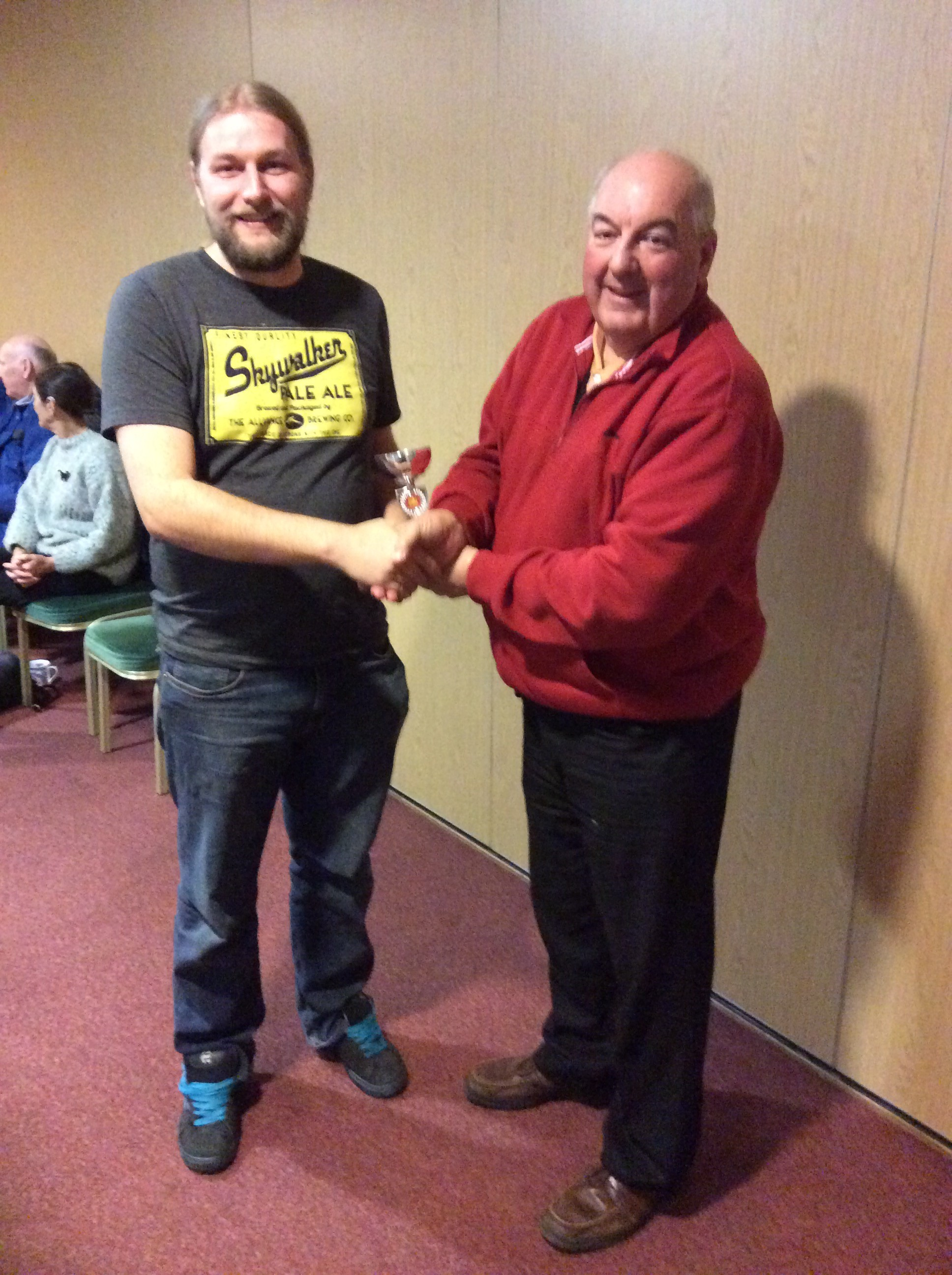 3rd XI Player of the Year - Dave Howe.     3rd XI skipper Sam Leach receives the award on behalf of Dave from the Club Chairman